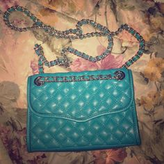 Stunning turquoise quilted REBECCA MINKOFF purse This is a beautiful quilted Rebecca Minkoff purse, worn very minimally. The turquoise is very unique, haven't seen much of this anywhere, and everything is in beautiful shape. A staple piece  no lowball offers, this is the lowest price you'd find for this purse. No dust bag but I package very carefully. No trades and no PP. Rebecca Minkoff Bags Crossbody Bags