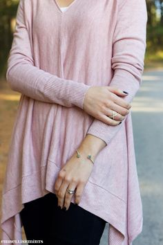 Boyfriend Sweaters can be hard to style so here are my tips on how to wear a boyfriend sweater. Learn how to turn yours frumpy sweater into a sexy one! www.Embellishmints.com