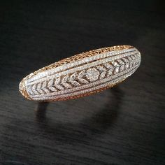 Aarya Jewelry presents this stunning rose and white gold bangle with white diamonds weighing 4.16 carats  #AaryaJewelry    #DiamondBangle #GoldBangle #DiamondJewelry #GoldJewelry #Bespoke #18k #Gold #Diamond #ForYou #ForHer #Gift #Sparkles #Love #Fashion #LuxuryLifestyle #luxuryfashion #HighFashion #LuxuryLife #Bangle #RoseGold #WhiteGold #Eternal #carat #WristGame #design #jewellery #instajewelry #DiamondsAreForever