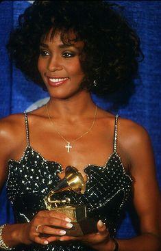 Whitney Houston 1987: Houston holds her award for best female pop vocal performance at the Grammy awards
