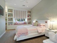 Children's room bedroom design idea with carpet & built-in shelving using beige colours - Bedroom photo 126380