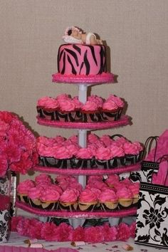 Hot pink and black zebra theme baby shower cupcakes. Have to keep this in mind if I ever have a girls baby shower for one of my girls. Pink Zebra Party, Baby Zebra, Pink Zebra Cakes, Baby Party, Baby Shower Parties, Baby Shower Gifts, Shower Baby, Zebra Baby Showers, Baby Girl Shower Themes