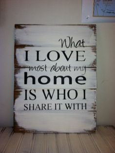 """What I love most about my home is who I share it with 13""""w x17 1/2""""h Hand-painted wood sign on Etsy, $31.00"""