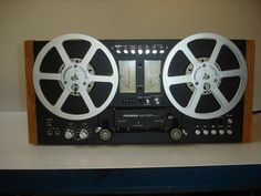 A rare 707 by Pioneer with black front and wooden side panels. A dream.