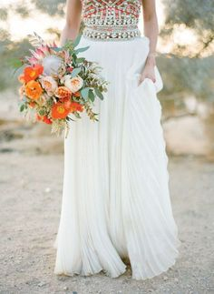 Between the bright bouquet + the elegantly studded wedding dress, this bride totally nailed the desert vibe.