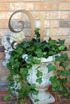 Container plants are monogrammable.  In case you were wondering . . . .  Metal letter stake is from Southern Proper Monograms.  $27.00.