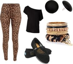 Spin on this outfit, leapord skirt, black belly shirt paired with black heels. Dancing outfit! (: