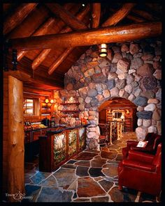 Gorgeous! Look at the art on the bar at this campy rustic cabin home.