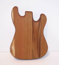 A Mini Guitar Cutting Board handcrafted from mixed hardwoods. Use it on the bar to cut up lemons and whatever. The Guitar measures 7 high x 4 1/2 wide. All the edges have been rounded over and both sides sanded smooth, then coated with mineral oil. Both sides of the Mini can be used.