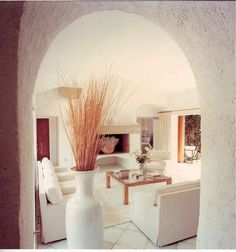 Total white with wooden touches for this #villa in #Sardinia