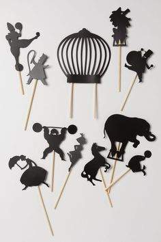 Circus Night-Time Shadow Puppets.  Create delightful stories and adventures in the dark with these sturdy cardboard shadow puppets in the shape of different circus acts including a ringmaster, clown, tightrope walker and performing animals.