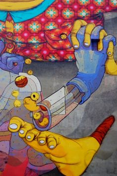 by artists: Aryz & Os Gemeos, in Lodz, Poland, 2012. *by Os Gêmeos. They are the identical twins, Otávio and Gustavo Pandolfo, born in São Paulo, Brazil, in 1974.