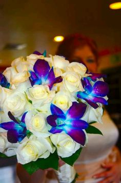 White roses and blue orchids. #Beach wedding     Beautiful bouquet.   #Tropical wedding   #destination wedding.  #Wedding in the bahamas