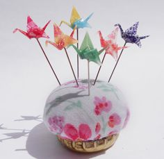Tiny paper crane pin toppers / decorative pins. For use in sewing projects, scrap booking, or just fun pincushion decoration.