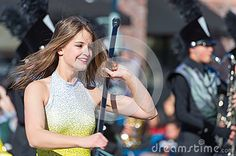 A flag girl in the Mason High School marching band in the 2016 Tournament of Roses parade in Pasadena.