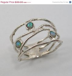Sterling silver opal ring. wave ring (sr-9773).