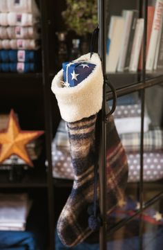 Stuffing Christmas socks!  View our Holiday 2014 Collection.  http://www.lexingtoncompany.com/home/holiday_collection