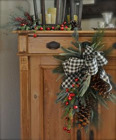 Like the homespun black and white ribbon with the antique brown of the pine