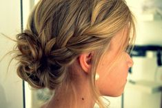 side braid into messy bun, thinking of doing something like this for lindsay's wedding.