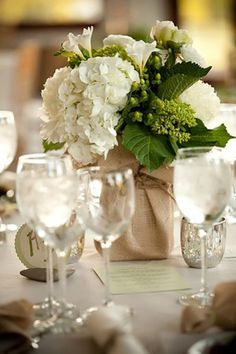 Burlap flower arrangements. Could cover a tin can...I like it cause I am cheap!