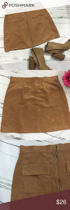 """Faux Suede Skirt Faux Suede Skirt in a Camel color with front zipper, two front pockets, fully lined.  Made of 100% Polyester.  Material is very soft and a very flattering skirt!   Approximately measures: Waist - 15 3/4"""" Hips - 19"""" Length - 17 3/4"""" Atmosphere Skirts"""