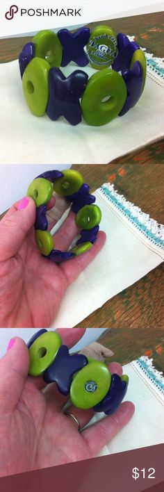 Purple & Green Tagua nut bracelet from Ecuador Tagua nuts are sliced into discs, carved and dyed and made into stretch bracelets. Free trade item and encouraging the froth of the endangered trees these nuts come from. The nuts can only be harvested when they are ripe and fall to ground. Tagua Jewelry Bracelets