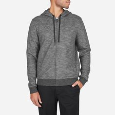 The iconic zip hoodie in a modern, upgraded fabric. It features classic set-in sleeves, lined hood, and topstitch seam detailing. The black drawstring is accented with silver tipping and matte black grommet. The marled fabric is a smooth, sleek cotton with a soft handfeel. The solid fabric is a similar weight but with a drier handfeel.