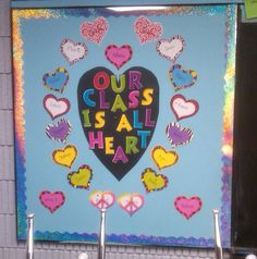 """Our Class is All Heart"" is a LOVE-ly title for a February bulletin board display. Kids could write acts of kindness they've done on the hearts, or send compliments to other students. Counselor Bulletin Boards, February Bulletin Boards, Preschool Bulletin Boards, Classroom Bulletin Boards, Bullentin Boards, Valentines Day Bulletin Board, Classroom Decor Themes, Classroom Ideas, Teacher Doors"
