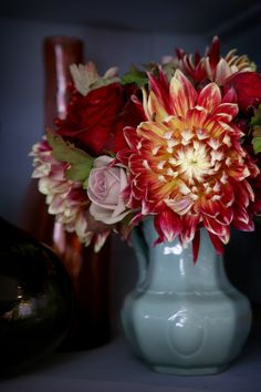 blue with the reds and pinks and oranges and yellows...love that color combo!