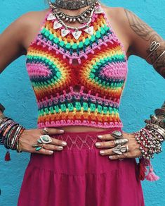 This crochet rainbow crop top is great for everyday use or for the upcoming festival season. It has adjustable straps an a corset back thatll help give you that perfect fit. Top looks perfect paired with a maxi skirt, high waisted shorts or jeans, or your choice of bikini bottoms.