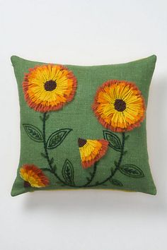 tufted sunflowers pillow. anthropologie. (which i will need to learn to make if i have any hope to own!)