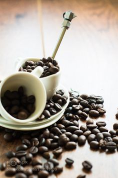 Coffee beans in the mug by AnnaBogush
