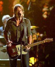 Keith Urban Photos Photos - Musician Keith Urban performs onstage at the 47th Annual Academy Of Country Music Awards held at the MGM Grand Garden Arena on April 1, 2012 in Las Vegas, Nevada. - 47th Annual Academy Of Country Music Awards - Show