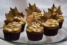Peanut butter chocolate chip cupcake with peanut butter buttercream icing. The leaves are handmade gum paste with a chocolate chunk sprinkle