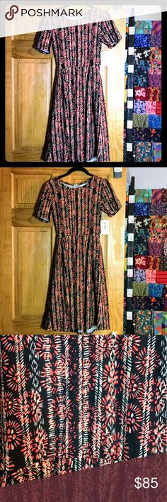 New! LuLaRoe Amelia Black & Red Dress! XS Gorgeous new dress by LuLaRoe. Black with orangish red and cream design. Size XS.  Zipper down the back and has pockets. Goes from day to night. Comfortable knit. Above for sizing. Not a consultant. Offers and questions welcome! LuLaRoe Dresses Midi