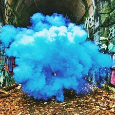 Crazy blue explosion in abandoned train tunnel by Candice Seplow.