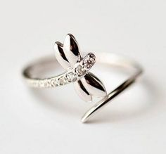 Beautiful 925 Sterling Silver Dragonfly ring! This ring is solid 925 Sterling Silver with CZ crystal, and is very high quality! The ring is adjustable and fits all sizes!