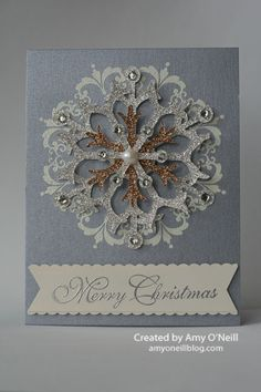 Stamps: Greetings of the Season, Daydream Medallions Ink: Versamark Paper: Brushed Silver card stock, Silver and Champagne Glimmer Paper, Very Vanilla Embellishments: Snow Flurry Bigz die, Silver Stampin' Emboss Powder, vanilla embossing powder (non-SU), Pearl Basic Jewels, Rhinestone Basic Jewels, Dotted Scallop Ribbon Border punch