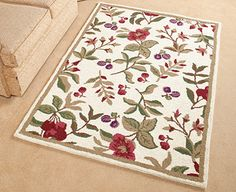 You won't find this beautiful rug anywhere else. Traditionally hand hooked, the dense pile boasts over 50 tufts of pure wool per square inch and features bold floral accents in Green, Red or Ivory. A cotton canvas backing adds durability while the fringeless border lends a clean and elegant finish. | Flowers and Berries Wool Rug | From £49.95 | Discover more at Scottsofstow.co.uk