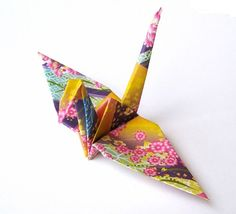 Creaseless origami cranes - Unlike origami cranes folded in a traditional method, these origami cranes do not have the liken in the middle of their wings. Purple Flower Pattern Origami Crane 50 Purple by GraceinCrease