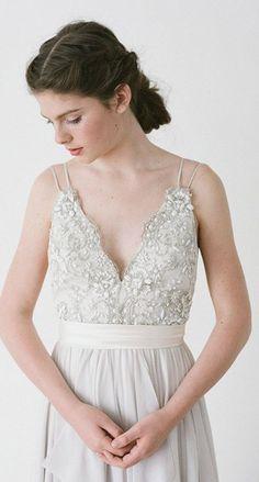 Unique double spaghetti strap wedding dress; Featured Dress: Truvelle Bridal