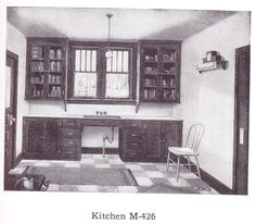 "Stained kitchen cabinets published in millwork catalog in1921 by the Morgan Woodwork Organization and called ""Building with Assurance."""