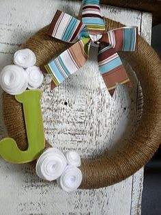 """The wreath for our front door. Replaced the """"J"""" with """"705"""" (house #) and changed the ribbon for a pink, green, white, taupe color scheme striped ribbon. @Emily Schoenfeld Schoenfeld Winkelman"""