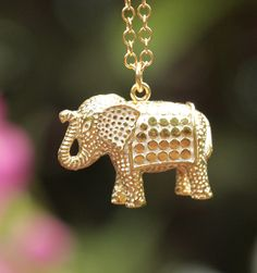 "Anna Beck Bali Elephant Necklace - Gold Plated over Sterling Silver Bali Elephant Pendant, 30"" chain.  From Anna Beck:  ""The Elephant has a brilliant mind and a soft heart.  She is loyal to the death and possesses the wisdom from the ancients.  She is confident and patient.  She will help remove all obstacles."""