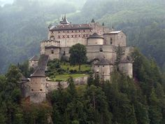 Hohenwerfen Castle overlooking Werfen, Austria was built in the 1070s. It overlooks the town of Werfen, Austria. For hundreds of years the fortification served the rulers of Salzberg, but it also served as a prison for numerous unfortunate persons, including several high profile figures.