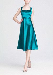 Vintage-inspired, this satin A-Linestyle combines modern sophistication with old hollywood glamour.   Wide strap tank bodice is supportive while sweetheart neckline is ultra feminine.  Tea-length skirt mixes flirty with flattering to create a timeless silhouette.  Lined Bodice. Back zip. Imported polyester. Dry clean only.