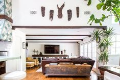 """Artist Sharlene Kayne calls her style """"evolutionary design."""" She adds layer after layer, piece by piece over time until it's done. Melrose Trading Post, Rose Bowl Flea Market, Barrel Ceiling, Rug World, Store Window Displays, Norwegian Wood, Moving Furniture, Modern Sconces, Transitional Living Rooms"""