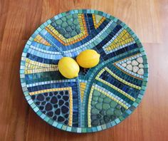 Large dish, measuring 45 cm / ~ 18 in diameter. Made with mini glazed ceramic tiles, glass tiles and cutted glass on bamboo dish. The varied textures in this dish create a very magical one of a kind piece of original art. Looks great on a table. Can be also hanged on a wall making a great decorational item. Big enough to catch anyones attention.