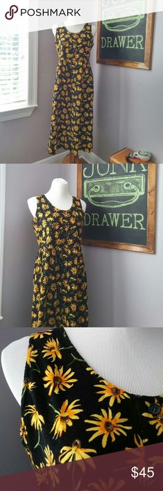 """Floral Buttondown Midi Corduroy Pocket Dress Sm Like New condition! So cute for Spring!. Lightweight Corduroy. Buttons all the way down front... And best feature... Pockets!! Such a unique dress. 100% cotton. Bust 18.5"""" Length 45"""". Daisy/ sunflowers/ black eyed Susan.  BUNDLE your likes and shoot me and OFFER! Glad to negotiate. Hundreds of items available for discounted bundle offers!  Follow on IG: @the.junk.drawer Vintage Dresses Midi"""