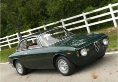 1967 Alfa Romeo Giulia Sprint GT Veloce < this one looks fantastic with the custom British Racing Green against the tan leather